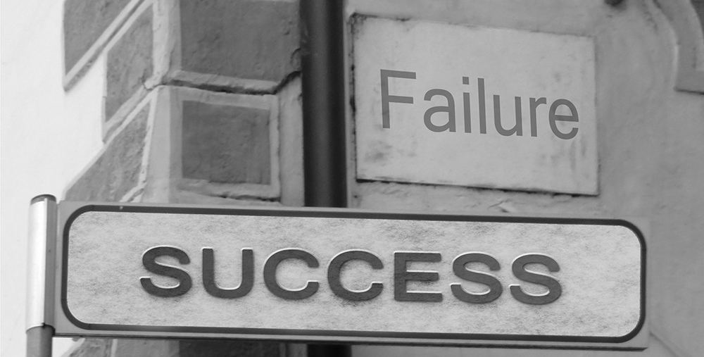 Failure and Success street signs, both lead us to success in goals.